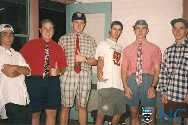 Photograph of residents wearing shorts and ties.